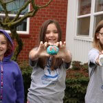 4th graders holding up their painted rocks